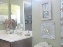 simple nautical bathroom decoration using aged wooden framed