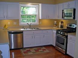 u shaped kitchen with island layout under cabinet light pendant