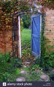 garden gate open door secret garden stock photo royalty free