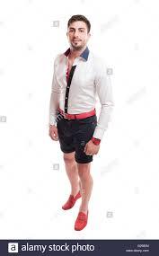 brunet model wearing black short pants white shirt and red belt