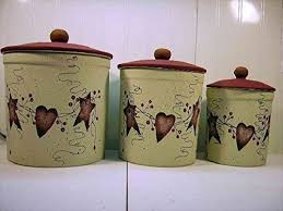 primitive kitchen canisters primitive country tin and hearts stoneware