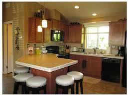 custom kitchen lighting breakfast nook white cabinets wood trim stainless steel appliances