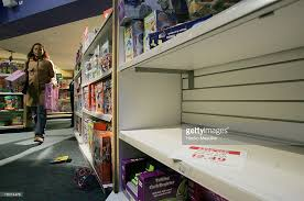an empty shelf is seen at toys r us in times square at 600 am an hour picture id78074479