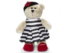 starbucks and alice olivia dress up a tumbler and a bear
