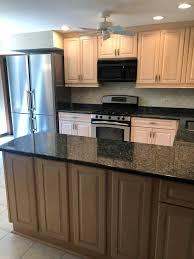 oak kitchen cabinets with stainless steel appliances beautfiul light wood custom kitchen complete liebherr stainless steel refrigerator range appliances green kitchens