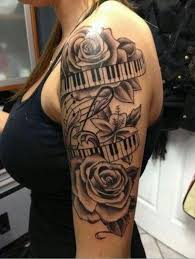 beautiful rose flowers with piano keys tattoo on left shoulder