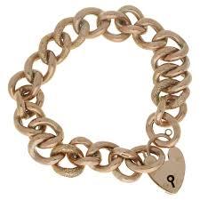 charm bracelet gold vintage images 1995 chanel gold and black woven leather novelty logo medallion jpg