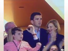 sibling rivalry eli manning has blank stare as family celebrates