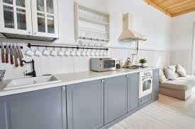 is paint or stain better for kitchen cabinets painted vs stained cabinets which one should you choose