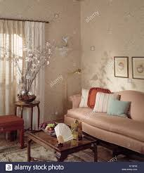 Oriental Wall Fan by Living Room Sofa Coffee Table Drapes Curtains Lamp Oriental Rug