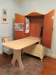 diy craft armoire with fold out table diy sewing cabinet might be a good way to save some space in our