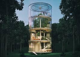 tubular glass house by aibek almassov wraps around a grown tree