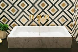 gold and black powder room with marble vessel sink contemporary