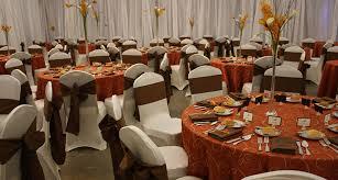 orange and brown centerpiece idea linen rental table linens