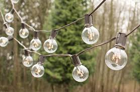 globe string lights brown wire globe string lights 2 in rice light bulbs 25 ft brown wire c9 clear