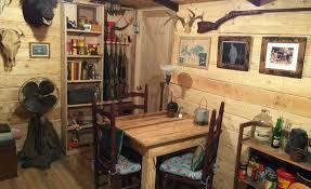 basement storage room transformed into cabin man cave cool material