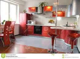 red modern kitchen interior of modern kitchen with a bar counter in red tones stock