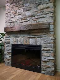 corner fireplace design with stack of stone also has white rack
