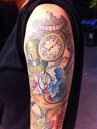alice in wonderland rabbit tattoo on half sleeve photo 1 photo