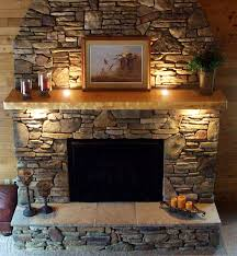 stones fireplace mantels with lighting and picture frame