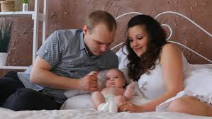 loving family relaxing and together on bed in bedroom