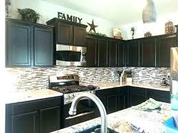 how to decorate above kitchen cabinets shaweetnails upper kitchen cabinet decor www stkittsvilla com