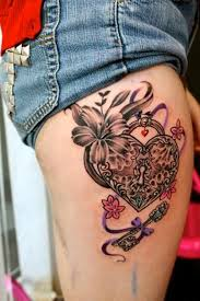 heart lock n key tattoo on back legs for couple real photo