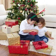happy brother and sister opening christmas gifts u2014 stock photo