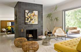 stacked grey stone fireplace mid century modern dining room wooden