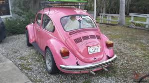 pink volkswagen beetle with eyelashes pink beetle car with eyelashes