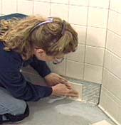 Installing Tile On Walls Hometime How To Ceramic Tile Installing Wall Tile