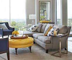 gray living room chair gray and yellow furniture decorating a living room with gray walls