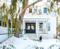 new houses being built with classic new england style a classic white new england farmhouse in maine