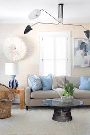 gray sofa with blue pillows and white juju hat transitional