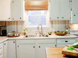 easy to clean kitchen backsplash kitchen with stripes backsplash and white cabinets an easy to