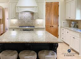 what color cabinets go with venetian gold granite how to update your granite countertops m interiors