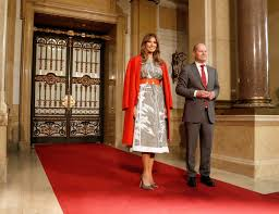 second designer hamburg photos melania is coat slinging fashionable again