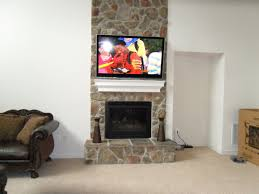 natural stone fireplace overmantle with wall mounted flat screen