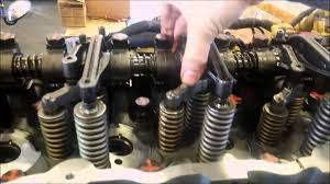how to adjust a cat overhead valve adjustment youtube