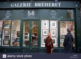paris france couple window shopping at picture framing store in