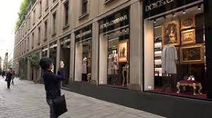 shop italy tourists shopping in capital of fashion milan italy stock