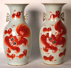 orange foo dogs two 19th c porcelain qing vases decorated with orange foo