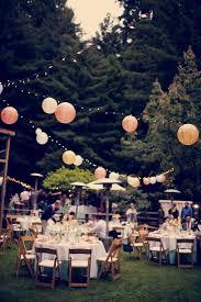 outdoor wedding reception tissue puff balls hanging on string
