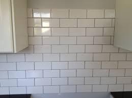 white grouting kitchen backsplash u2014 railing stairs and kitchen
