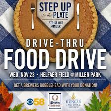 thanksgiving drive thru food drive in swing at miller park