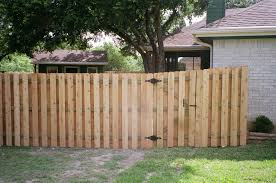 staggered slats dog fence ideas pinterest wood fence gates