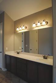 bathroom light fixtures above mirror installing bathroom light fixture over mirror with regard to