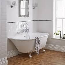 Laminate Wood Flooring Bathroom Bathroom Cozy Laminate Wood Flooring With White Baseboard And