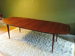 mid century walnut dining table mid century modern tapered surfboard walnut dining table by