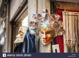 venetian carnival costumes for sale colourful golden masks for venice carnival on display in a